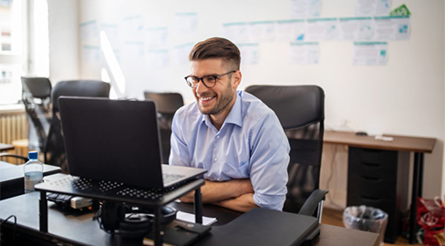 a man laughing at the computor