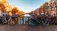 Bicycles-parked-on-a-bridge-in-Amsterdam-reduced